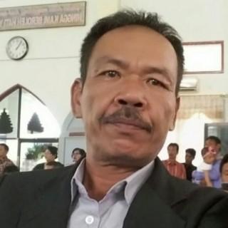 MONANG SIPANGKAR,S.PD